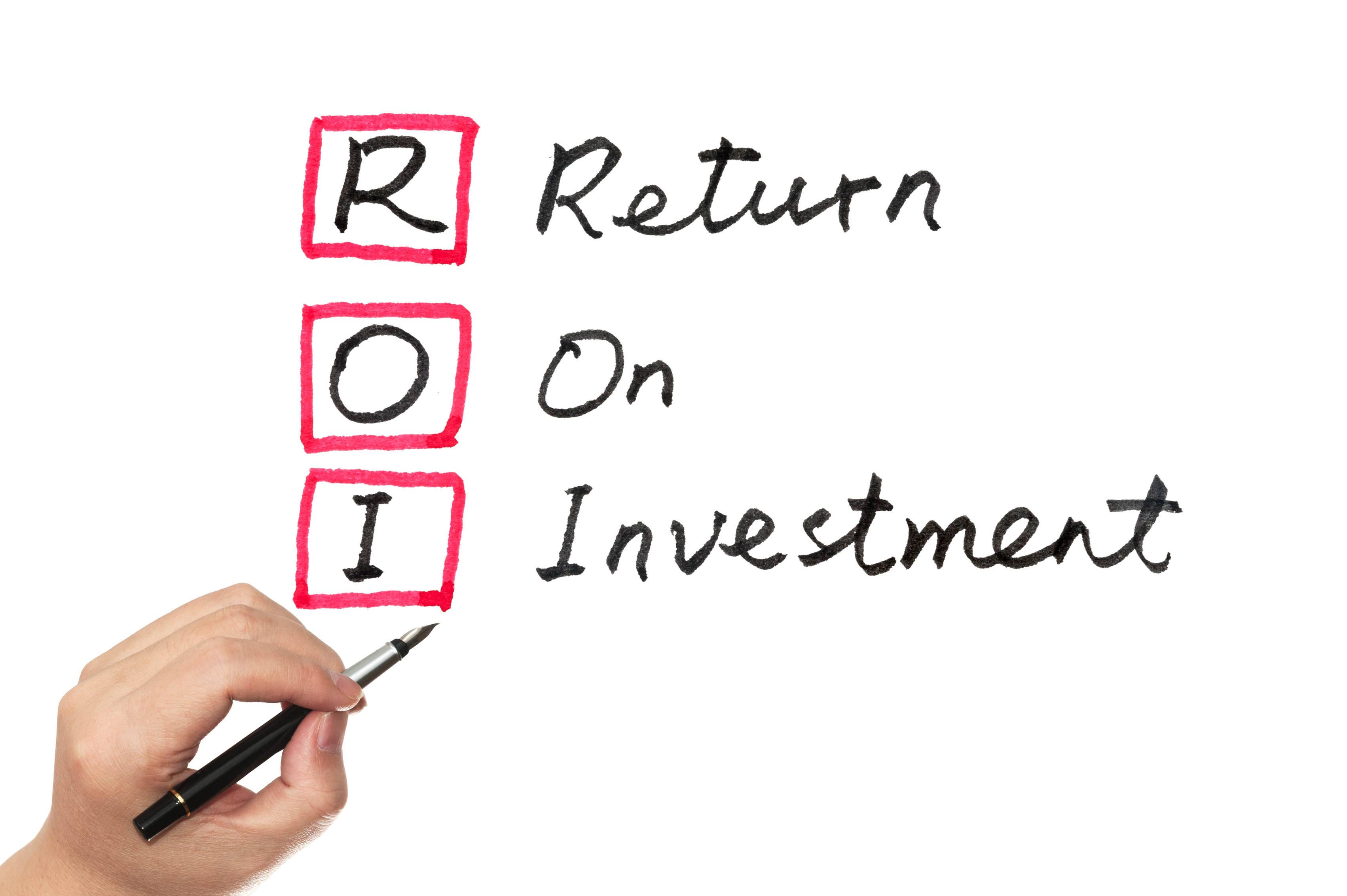 ROI (return on investment) words written on white board
